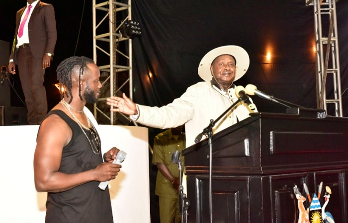 Bebe Cool looks on as the President addresses the patrons at Kololo Airstrip