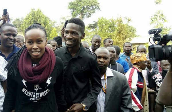 Barbie and Bobi Wine in the queue waiting to cast their votes