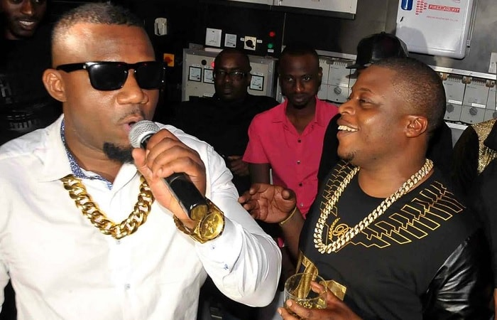 Cameroon Gitawo and the late Ivan Semwanga at one of the end of year parties in Kampala