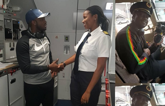 Bebe Cool shares a light moment with a female pilot