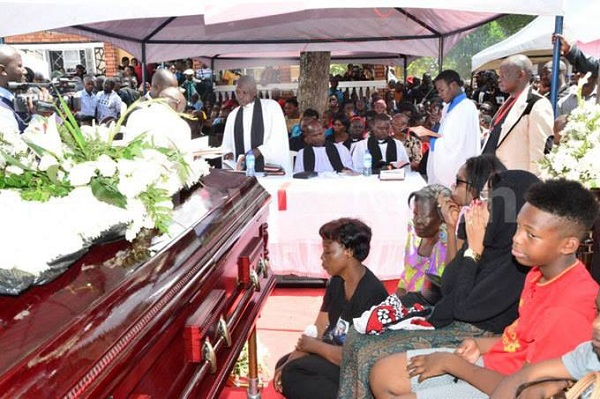 Mourners at Kayunga earlier in the day for Ivan Semwanga's burial