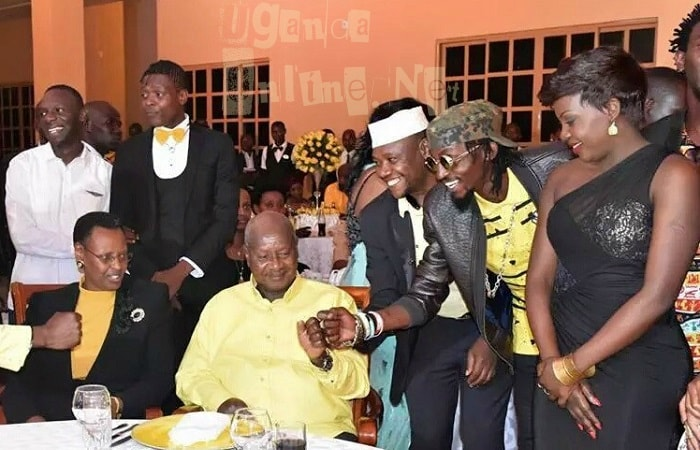 President Museveni fist thumps Moze Radio at Munyonyo