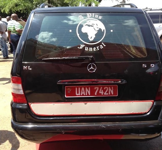 Ivan's casket inside the hearse car ready for the final journey in Kayunga