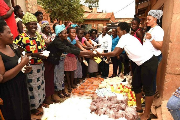 The birthday girl giving out goodies to women in Banda