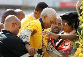 South African Icon Nelson Mandela is being helped up the stage on 19 Apr 2009.
