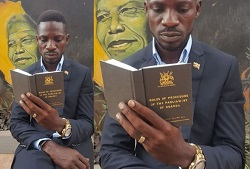 Bobi Wine reading the rules of parliament